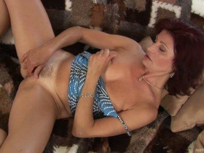 Mature hooker Wanda treats her hairy cunt with big blue vibrator