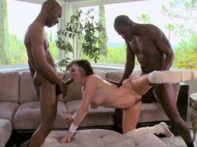 Sporty granny Alexandra Silk trains her skills with two black dicks