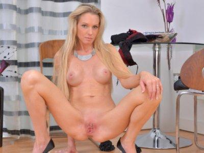 Sexy blonde milf fucks her tight snatch
