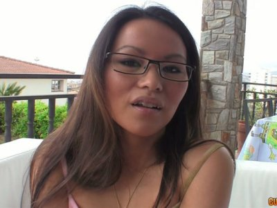 Cute Asian girl gives her boyfriend eager blowjob