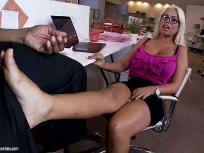 Slutty office worker Bridgette B sucks her boss' dick right at the desk