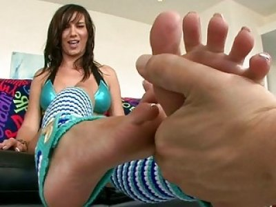 Chick offers footjob in open air