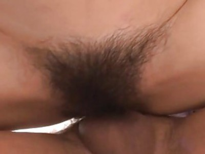 Asian take on two large fake dong in hairy cunt