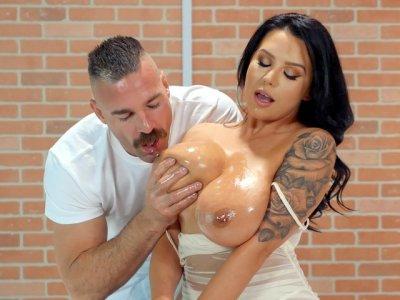 Sheridan Love gets her big natural tits oiled